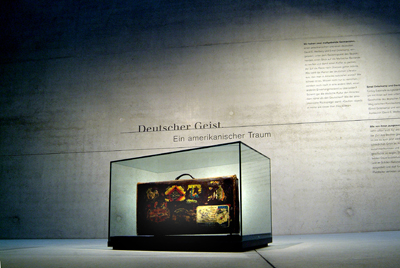 an image of a museum with a suitcase